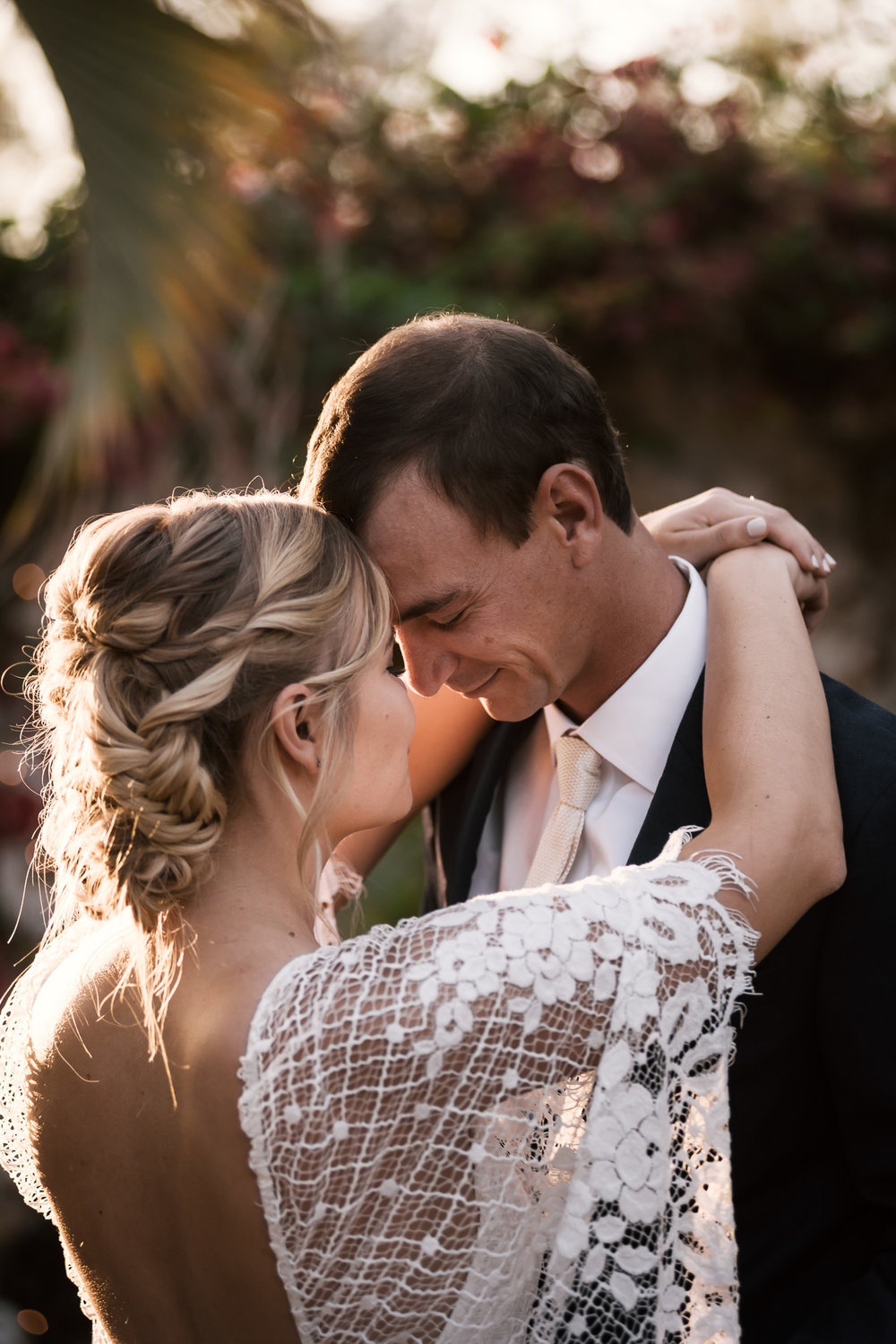 happy bride and groom hold each other close captured by photographer during romantic wedding at the historic Leo Carrillo Ranch in Carlsbad California