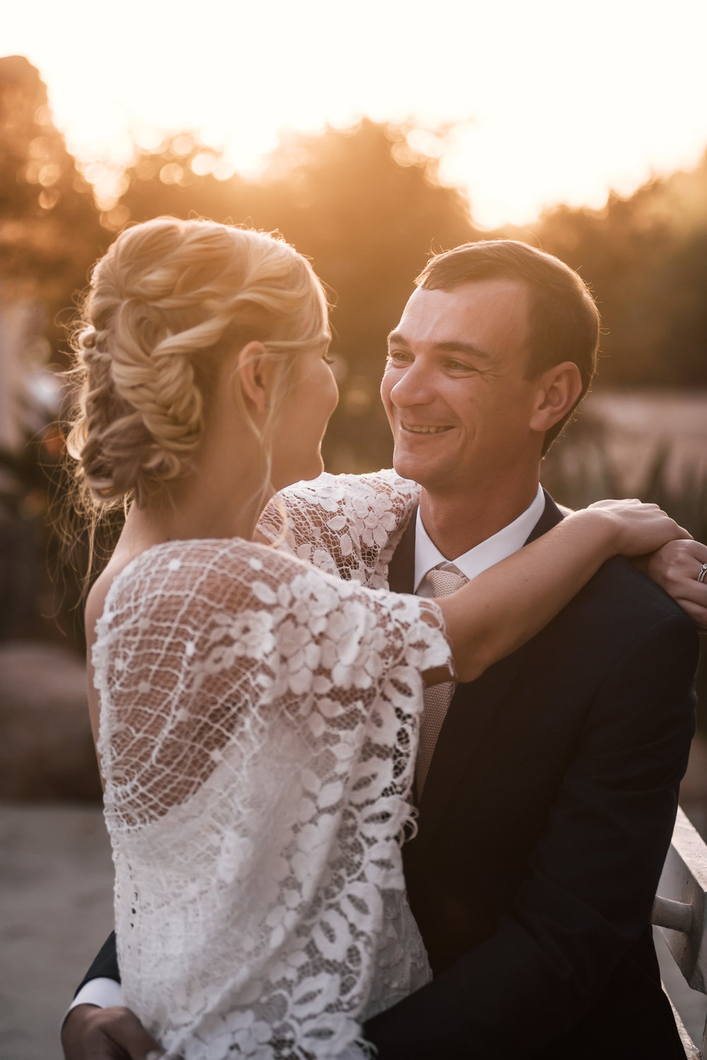 sunset romantic portrait of couple captured by photographer during romantic wedding at the historic Leo Carrillo Ranch in Carlsbad California