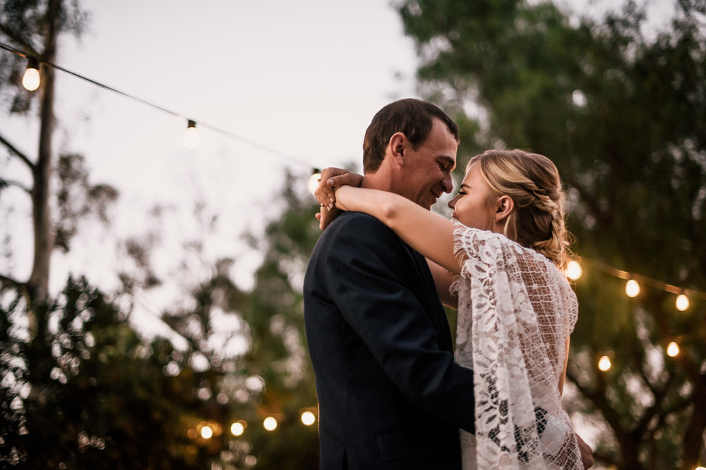 tender moments during first dance captured by photographer during romantic wedding at the historic Leo Carrillo Ranch in Carlsbad California