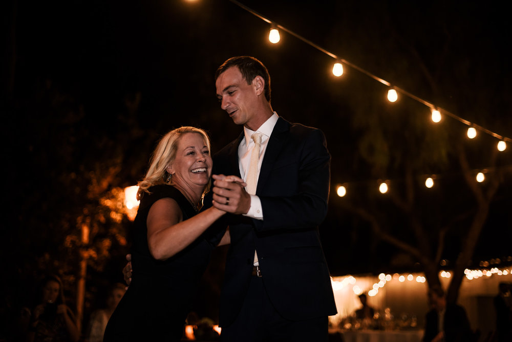mom and son dance at wedding reception captured by photographer during romantic wedding at the historic Leo Carrillo Ranch in Carlsbad California