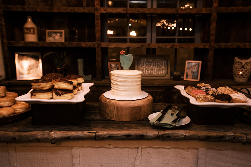 desert table ideas with doughnuts and cactus cake topper captured by photographer during romantic wedding at the historic Leo Carrillo Ranch in Carlsbad California
