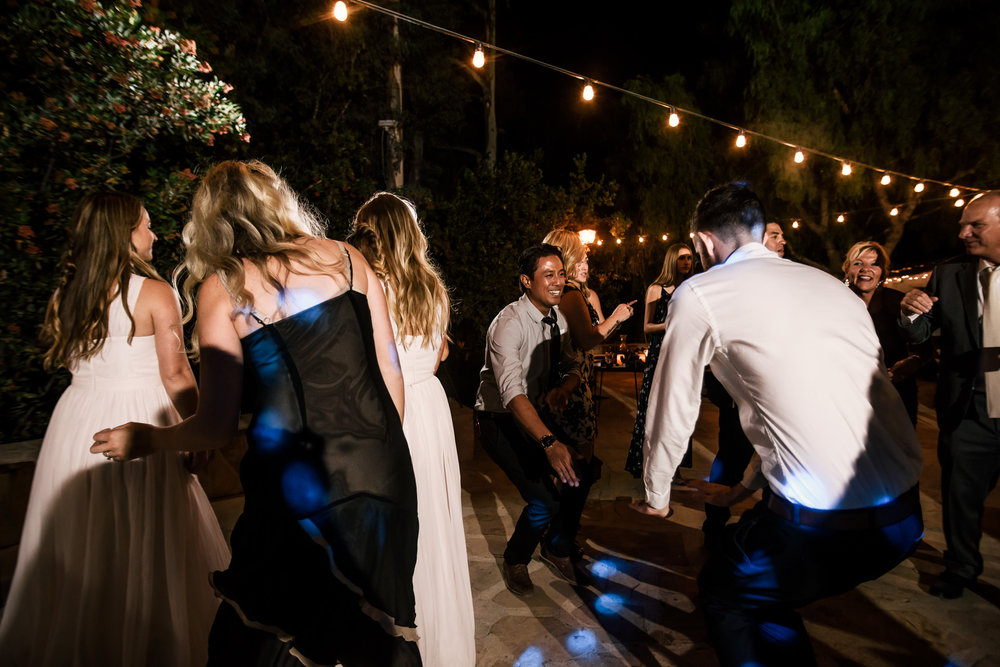 guests tear it up on the dance floor captured by photographer during romantic wedding at the historic Leo Carrillo Ranch in Carlsbad California