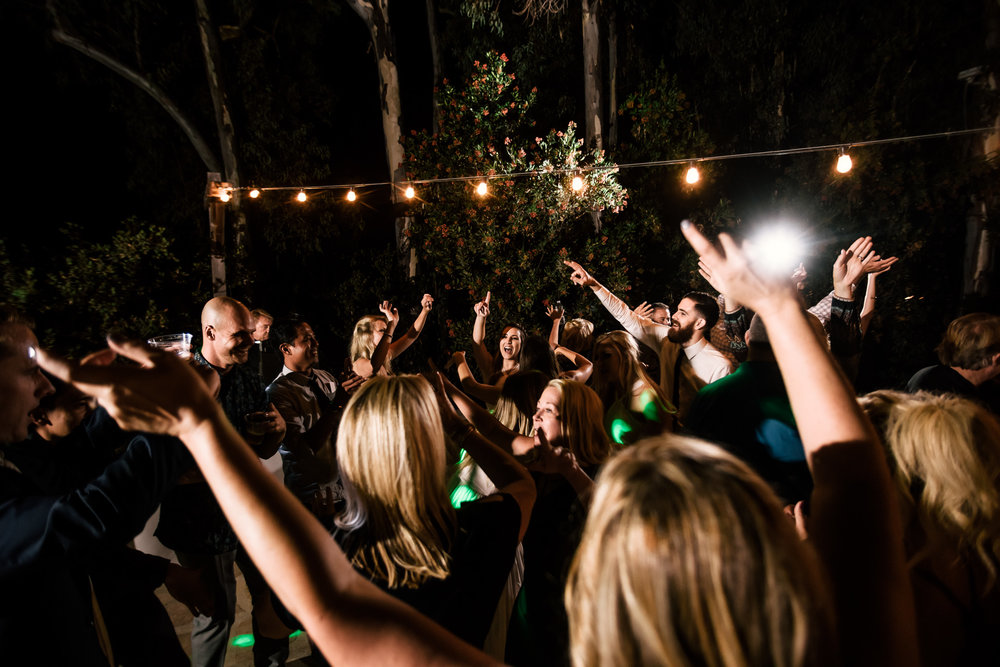 Guests get the party gets started captured by photographer during romantic wedding at the historic Leo Carrillo Ranch in Carlsbad California