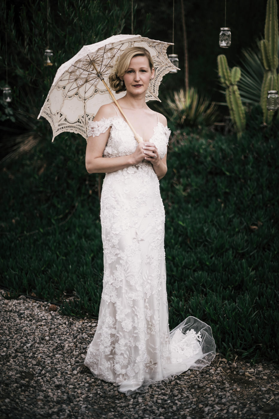 every vintage bride should have a white lace parosal like this one at the whispering oaks terrace in temecula california
