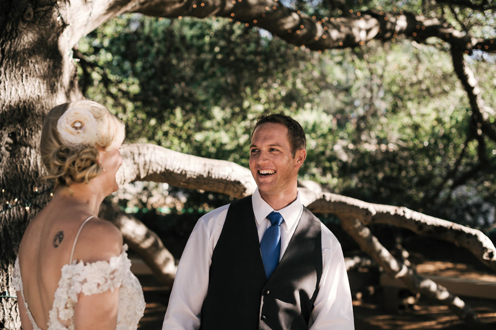 happy look on the grooms face as he sees his bride in her wedding dress for the first time