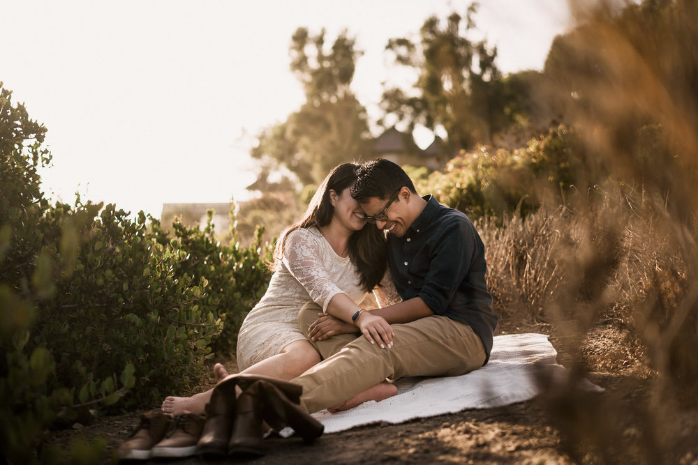 Romantic engagement picnic at El Matador state beach in Malibu California at Sunset