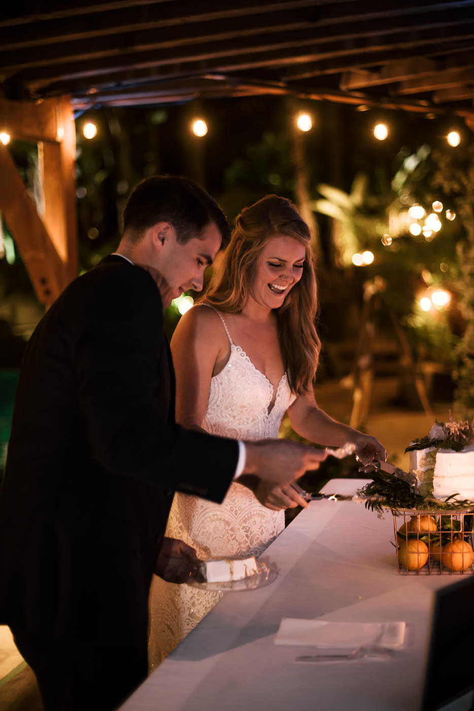 Couple has a blast cutting their beautiful wedding cake at the reception in Temecula California