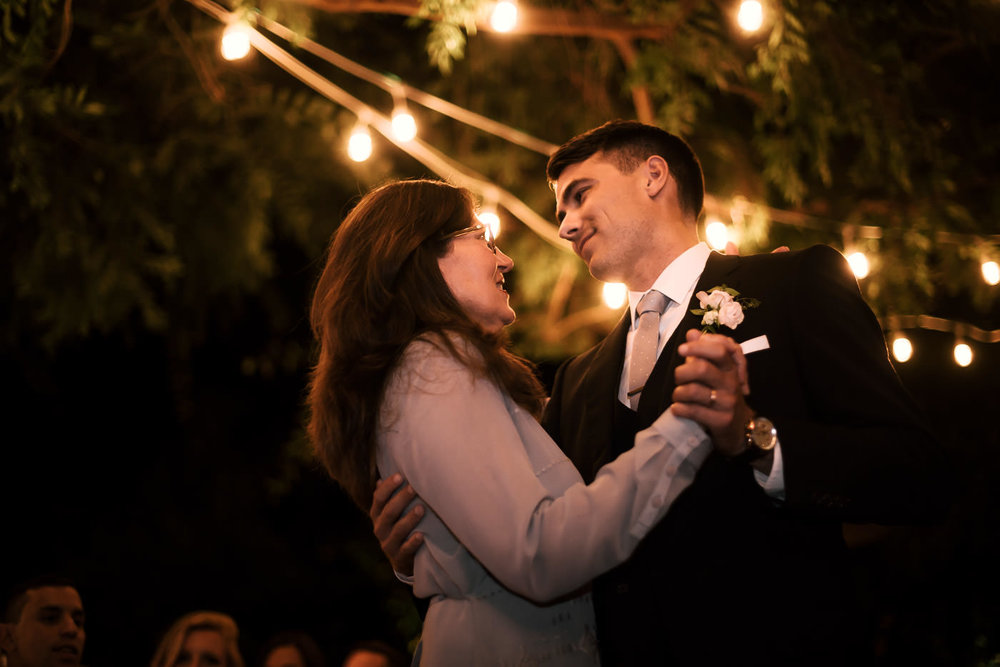 Mother dances with the groom at his beautiful wedding recpetion in Temecula California