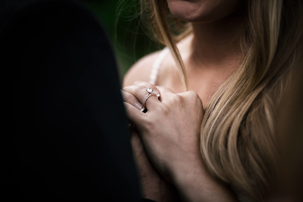 Wedding photographer takes this stunning shot of the brides ring as the beautiful couple holds hands,