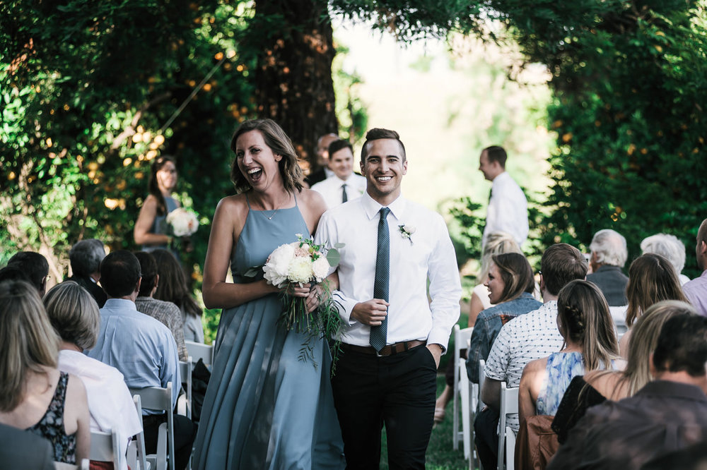 Wedding party is all smiles after a romantic wedding in Temecula captured by a California photographer.