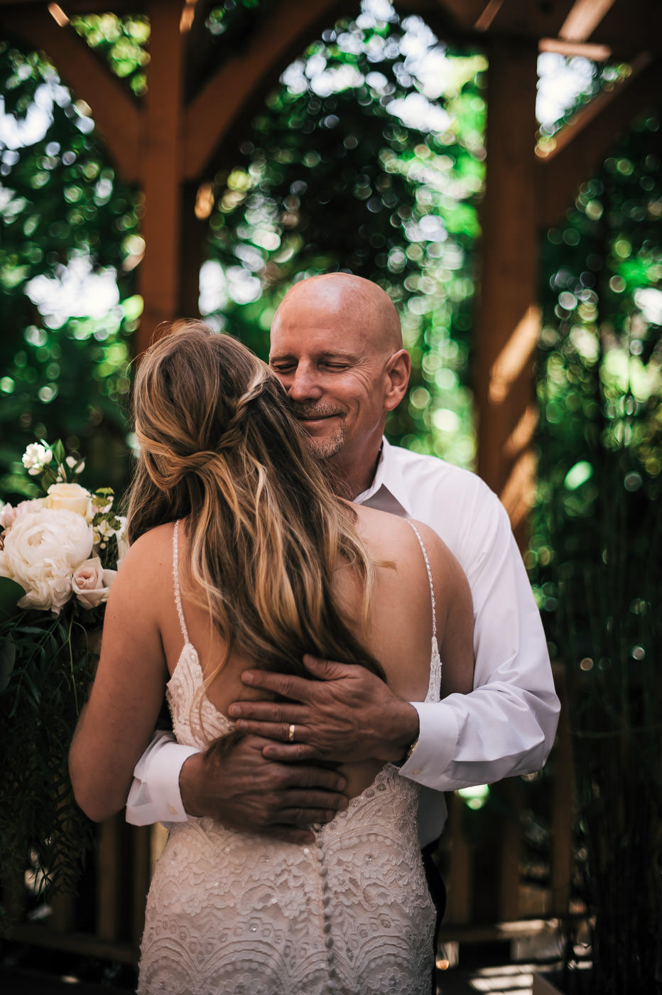 Father of the bride is overcome with joy as he hugs his daughter tightly before the Temecula wedding.