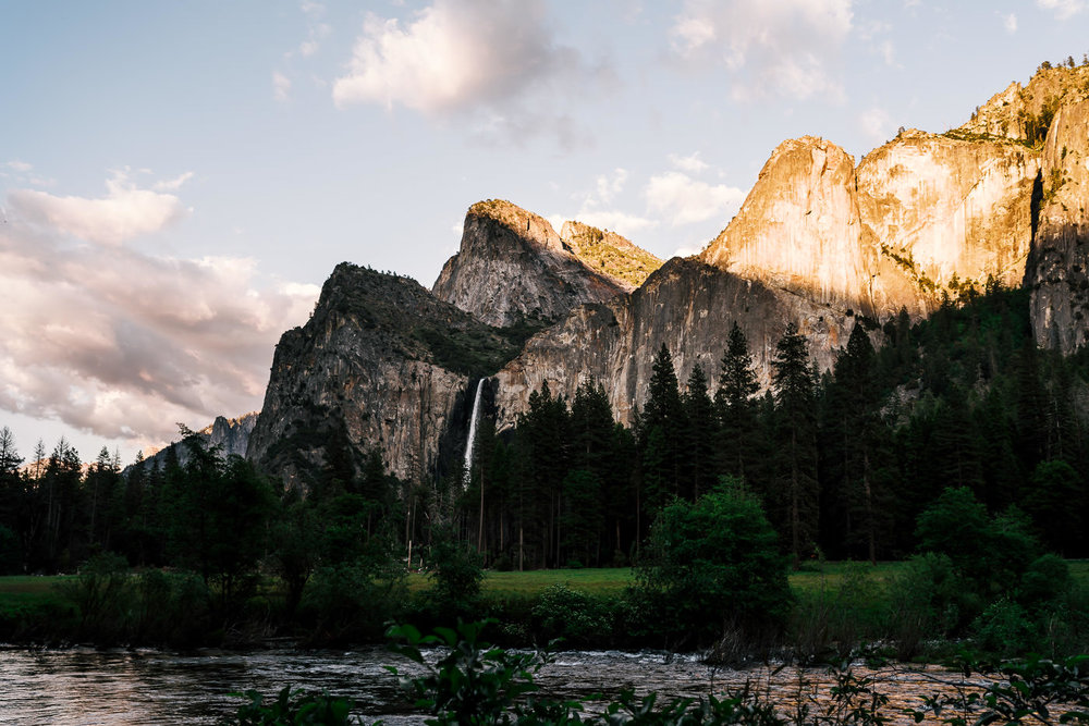 Bridalveil Falls with the merced river in the foreground at sunset photographed in Yosemite National Park.