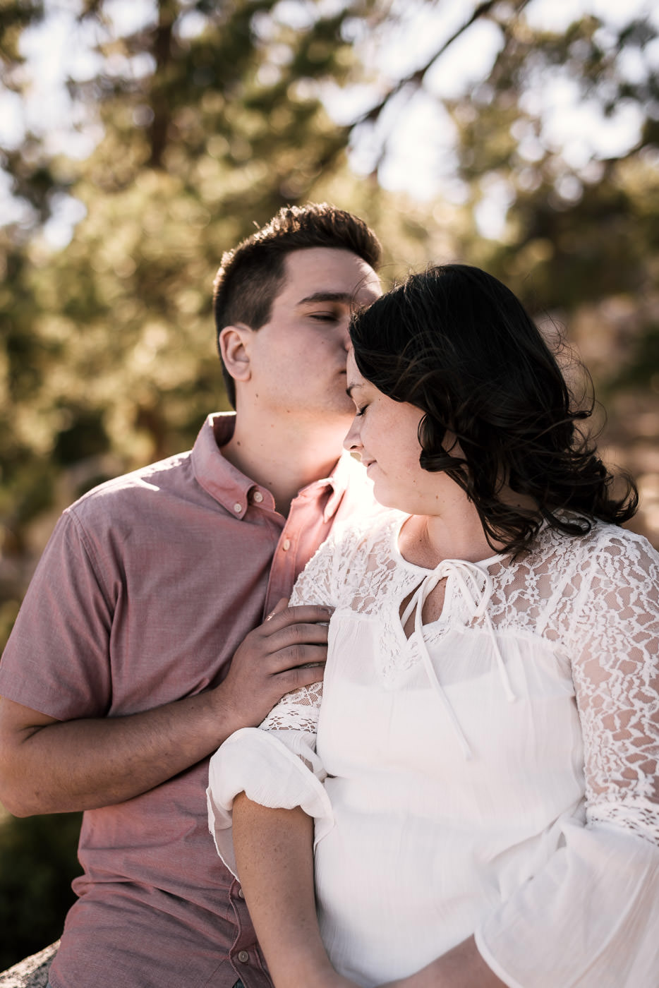 Sweet forehead kisses during this engagement shoot.