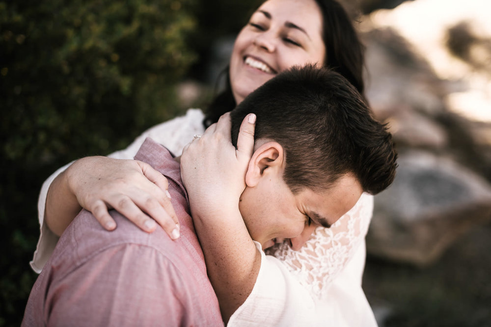 sweet couple laughs during their engagement shoot at Mt San Jacinto