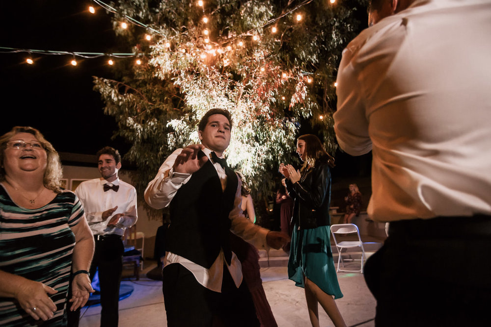 Groom parties with his guests on the dance floor