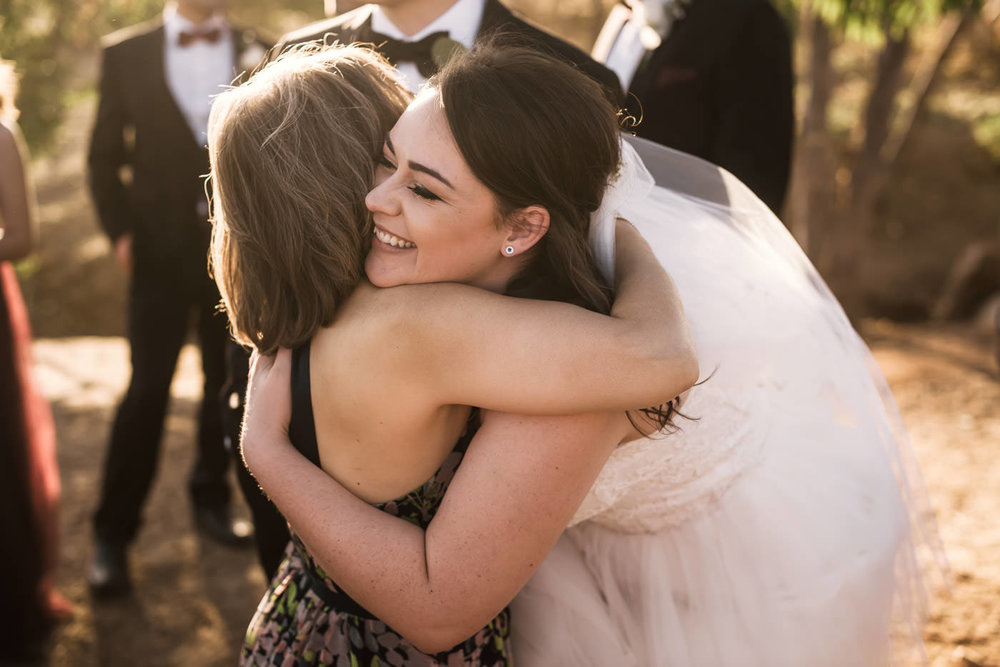 Bride hugs her new mother in law after the wedding ceremony.