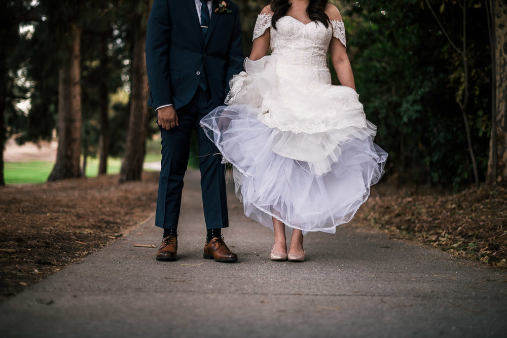 Great wedding photo Idea; bride and groom show off their shoes.