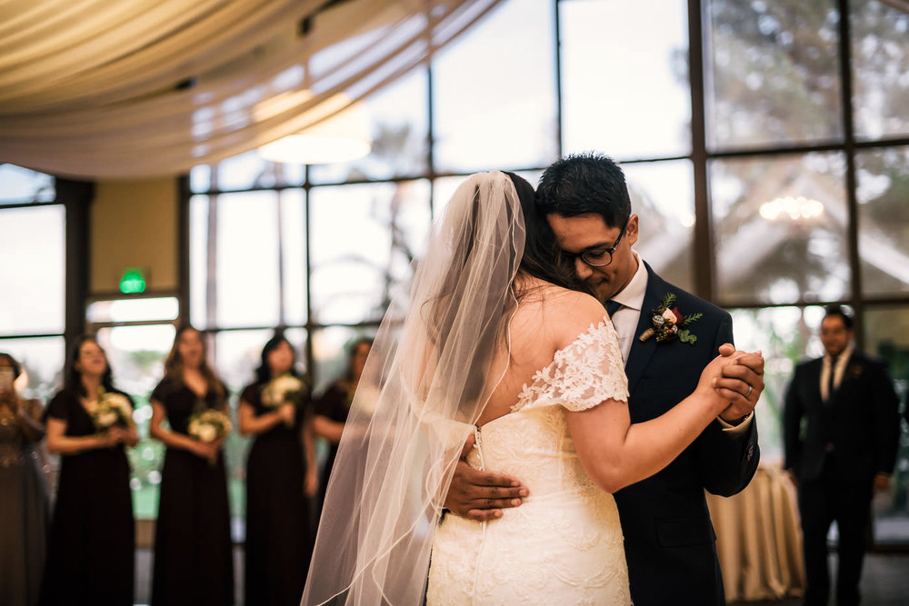 Couple shares a romantic first dance at Knollwood Country Club wedding.