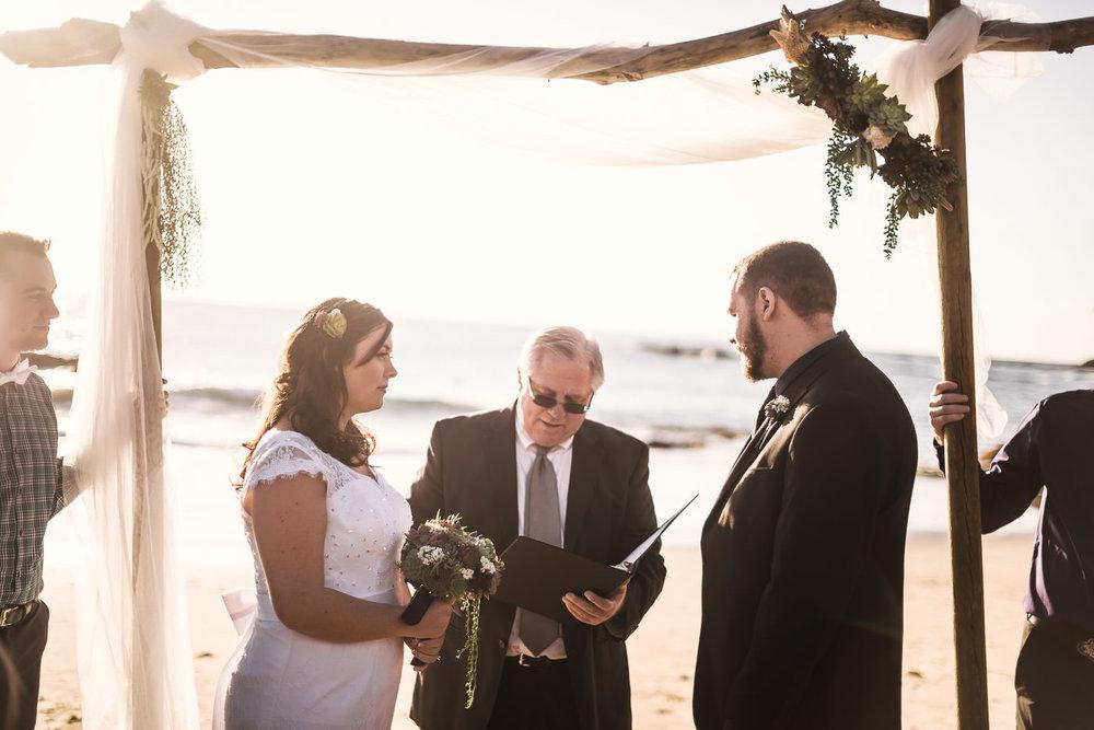 Beautiful Laguna Beach wedding ceremony captured by photographer at sunset.