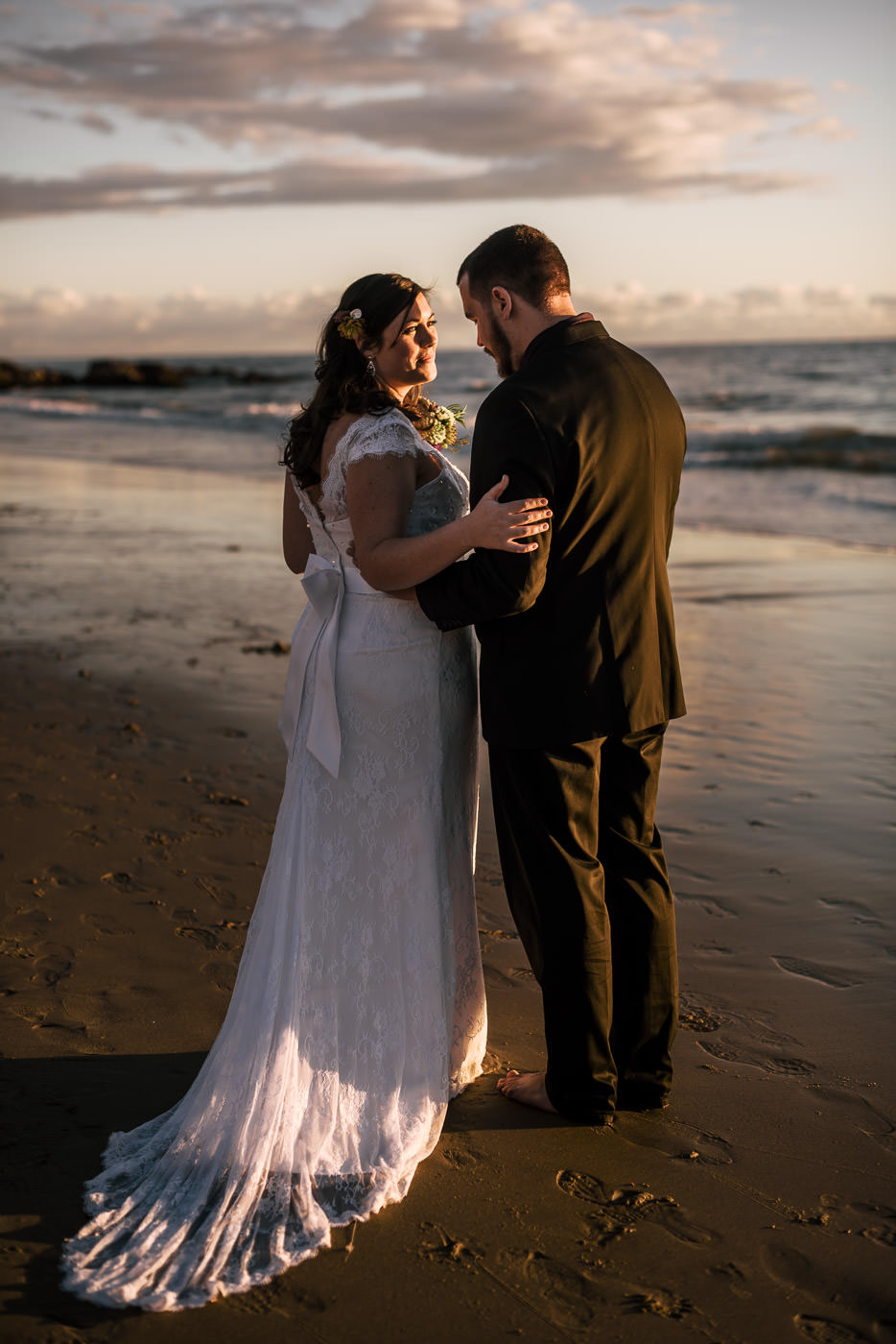 Dramatic photo of a newly married bride and groom at Laguna Beach.