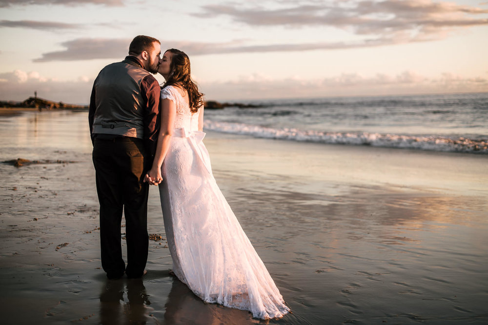 Wedding Photographer near Laguna beach takes a romantic photograph at sunset.