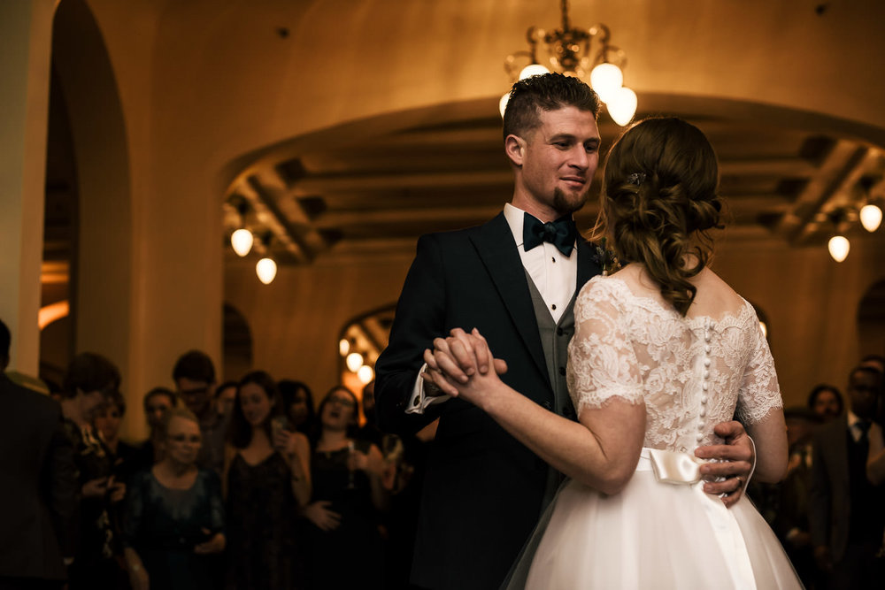 Romantic first dance at wedding reception in the Castle Green's banquet hall.