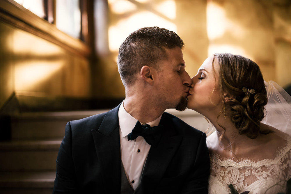bride and groom enjoy a tender kiss after their romantic first look at the Castle Green in Pasadena