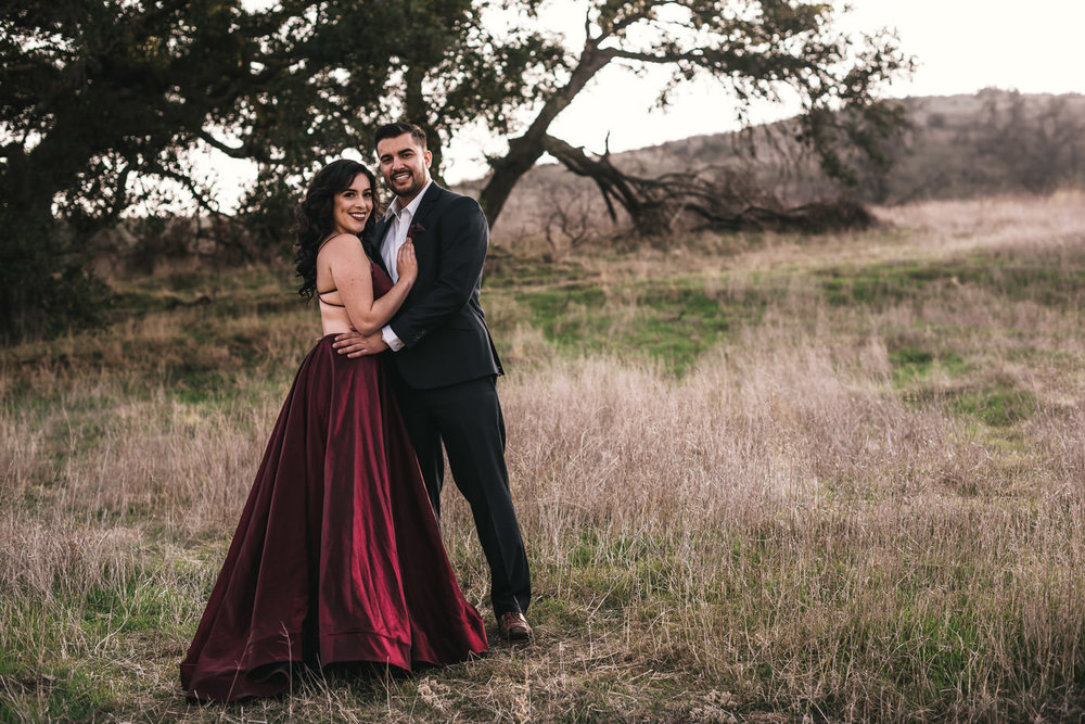Engaged couple poses for their California wedding photographer.