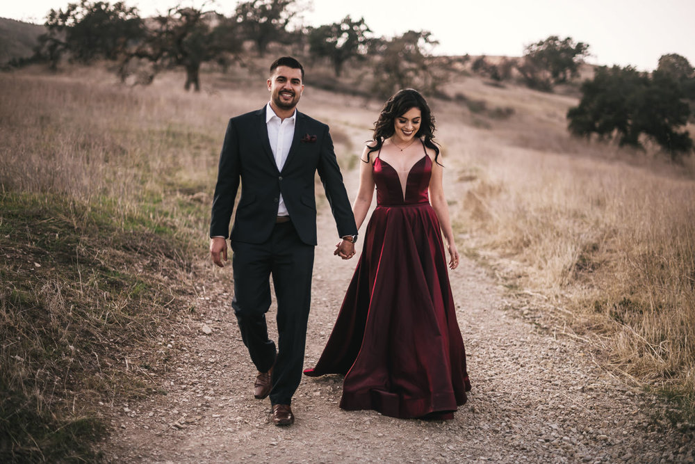 Stylish bride and groom go for a romantic walk among the oak trees of Malibu California.