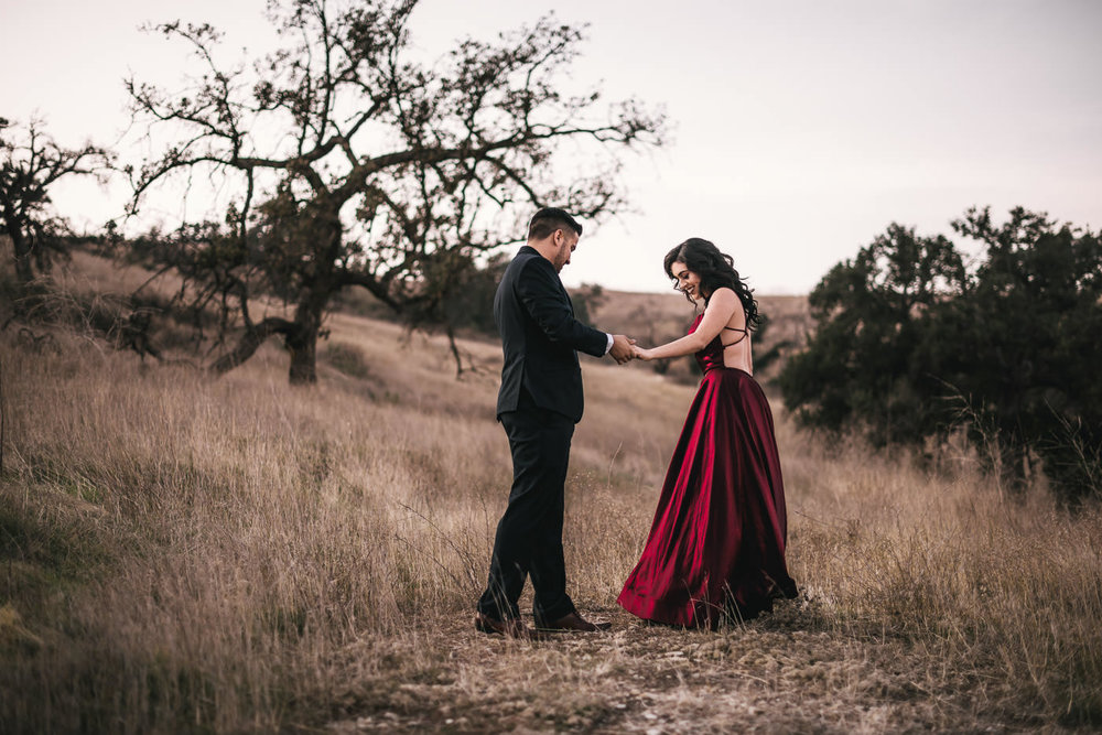 Future bride picks absolutely stunning red dress for her engagement session.