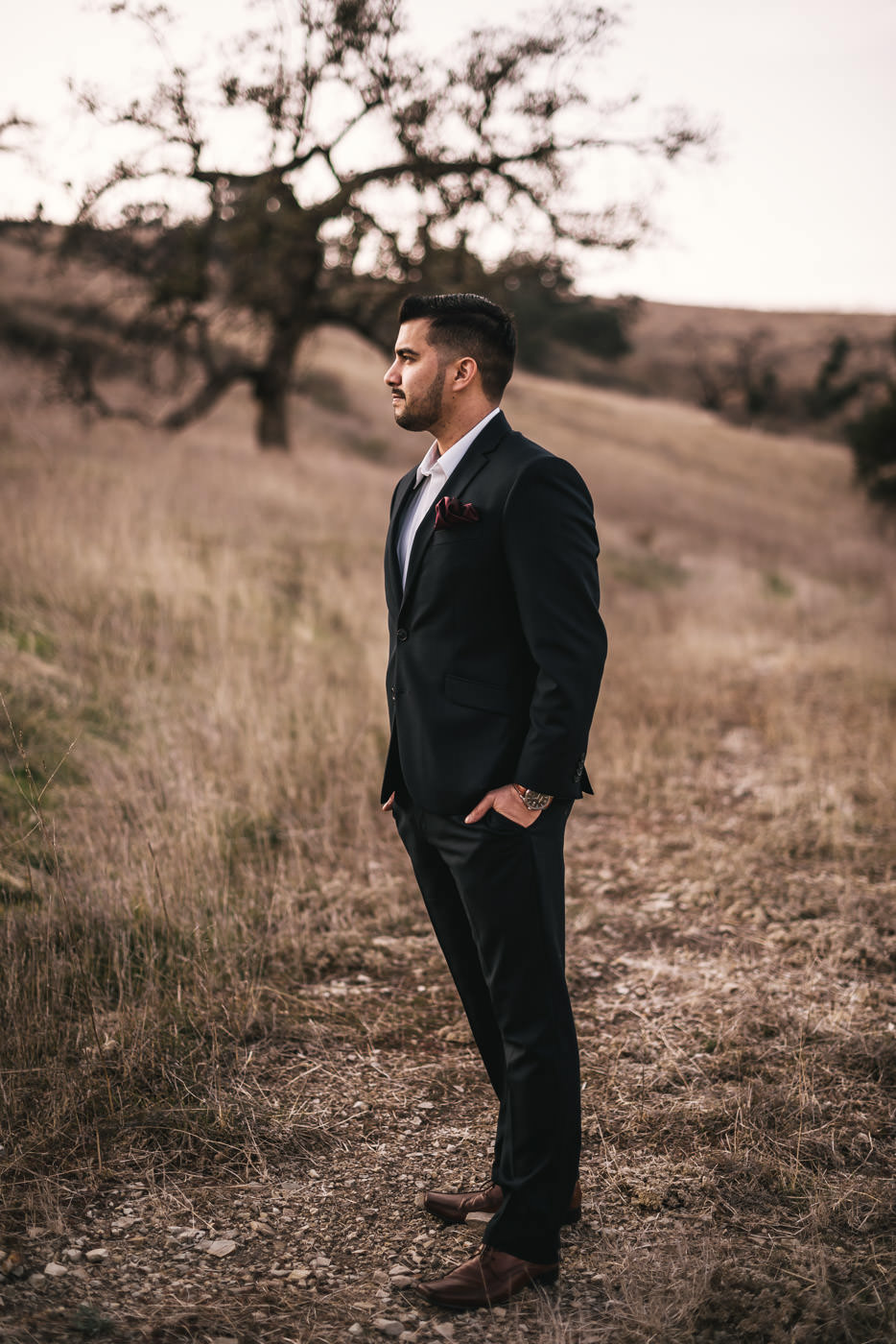 Romantic portrait of a groom at his engagement session.