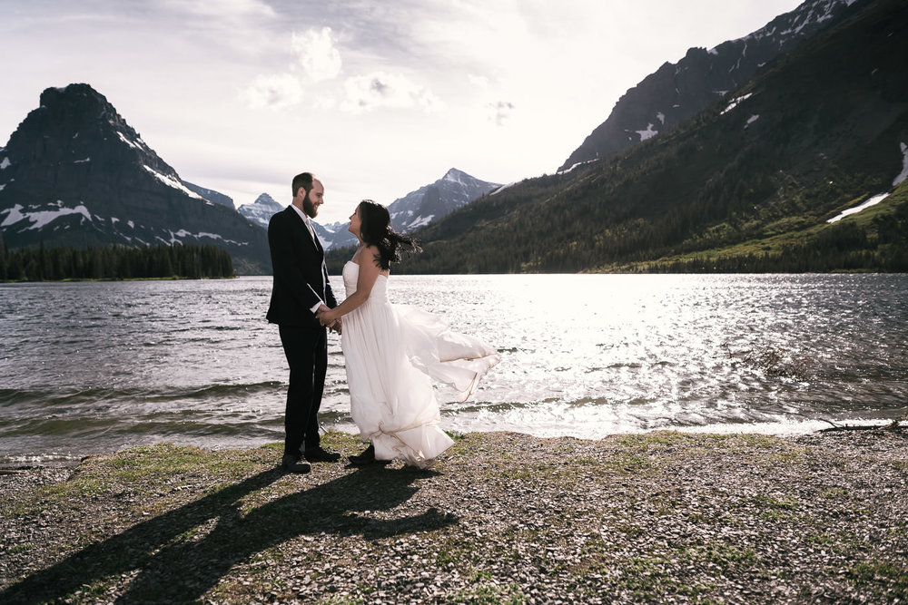 What all am I willing to do as your elopement photographer? - The sky is pretty much the limit. Drive up to Yosemite National Park to spend the day exploring the valley? Get the weddings rings, I'm on my way. Maybe that's not adventurous enough for you and you'd rather backpack into the wilderness and have an elopement atop a soaring granite peak in Glacier National Park? When do we leave? Jumping in lakes? Camping on the beach? Kayaking the Colorado river? Let's go! No matter where your destination is or what we may be doing, let's have a fantastic time. Wander off the beaten path and enjoy the indescribable joy of eloping with your best friend to the National Parks.