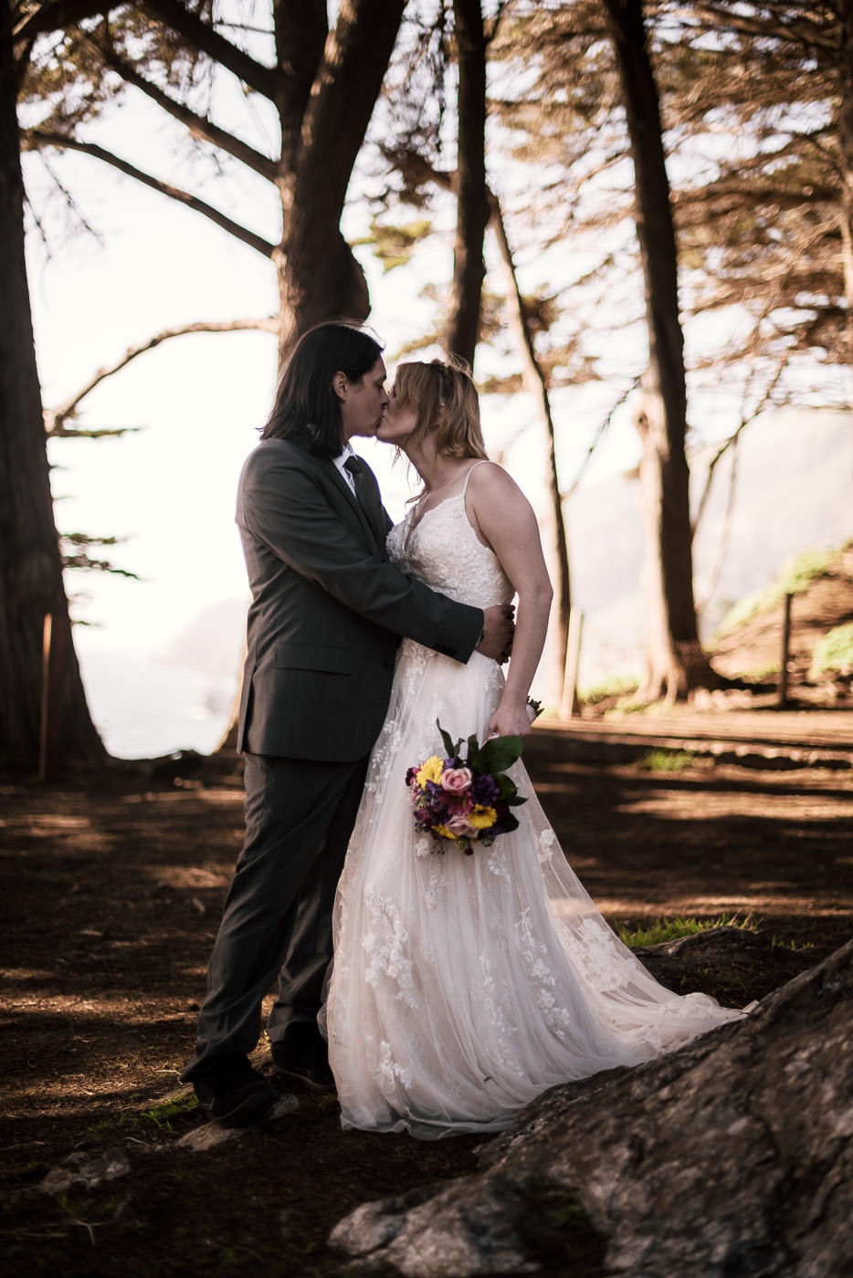 Kiss beneath the pines on the coast of California.