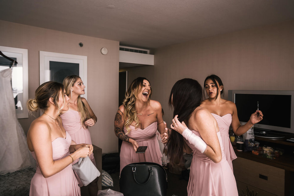 Bridesmaids laugh as the prepare for the big day.