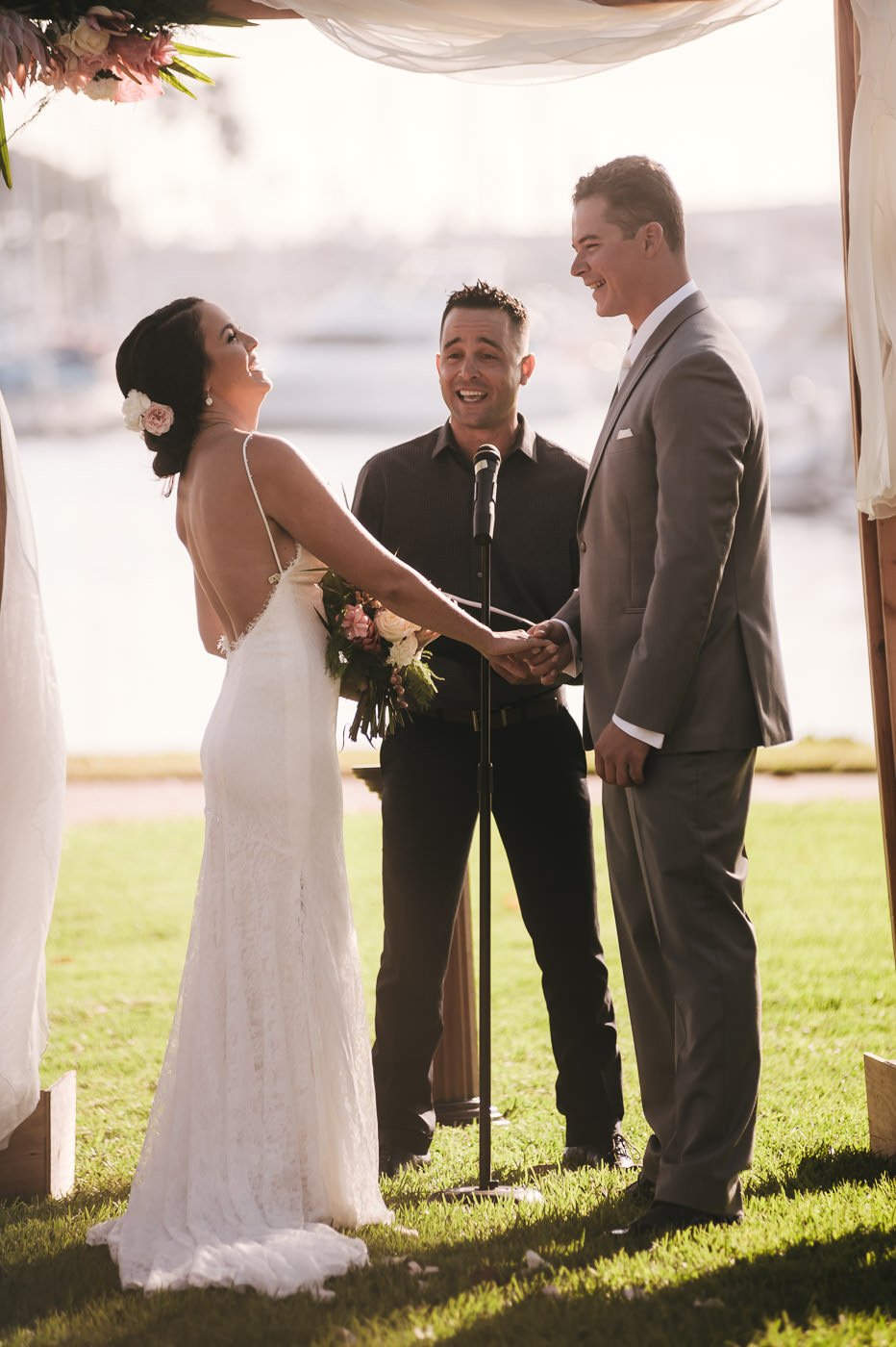 Marriage Officiant makes the bride and groom laugh during the ceremony.