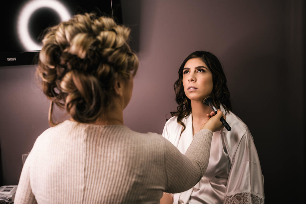 Professional makeup artist gets the bride ready fro her big day.