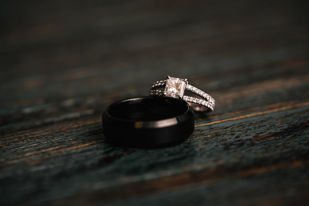 Beautiful dimond engagement ring and black wedding band.