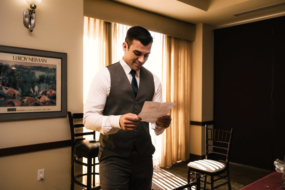 Groom reads a letter from his future wife before their ceremony.