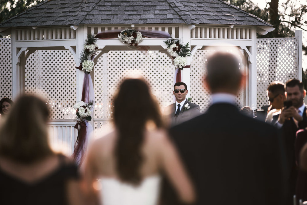 Groom smiles as he sees his bride for the first time.