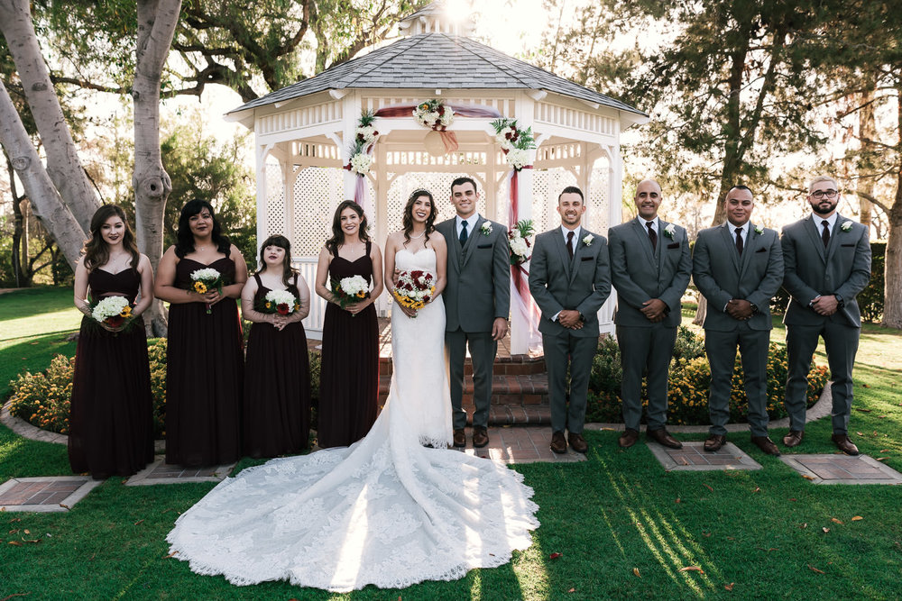 Bridal party poses in fornt of the white gazebo at the Alta Vista Country Club.