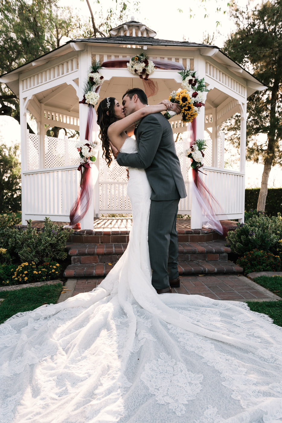Placentia wedding photographer captures a romantic kiss at the Alta Vista Country Club.