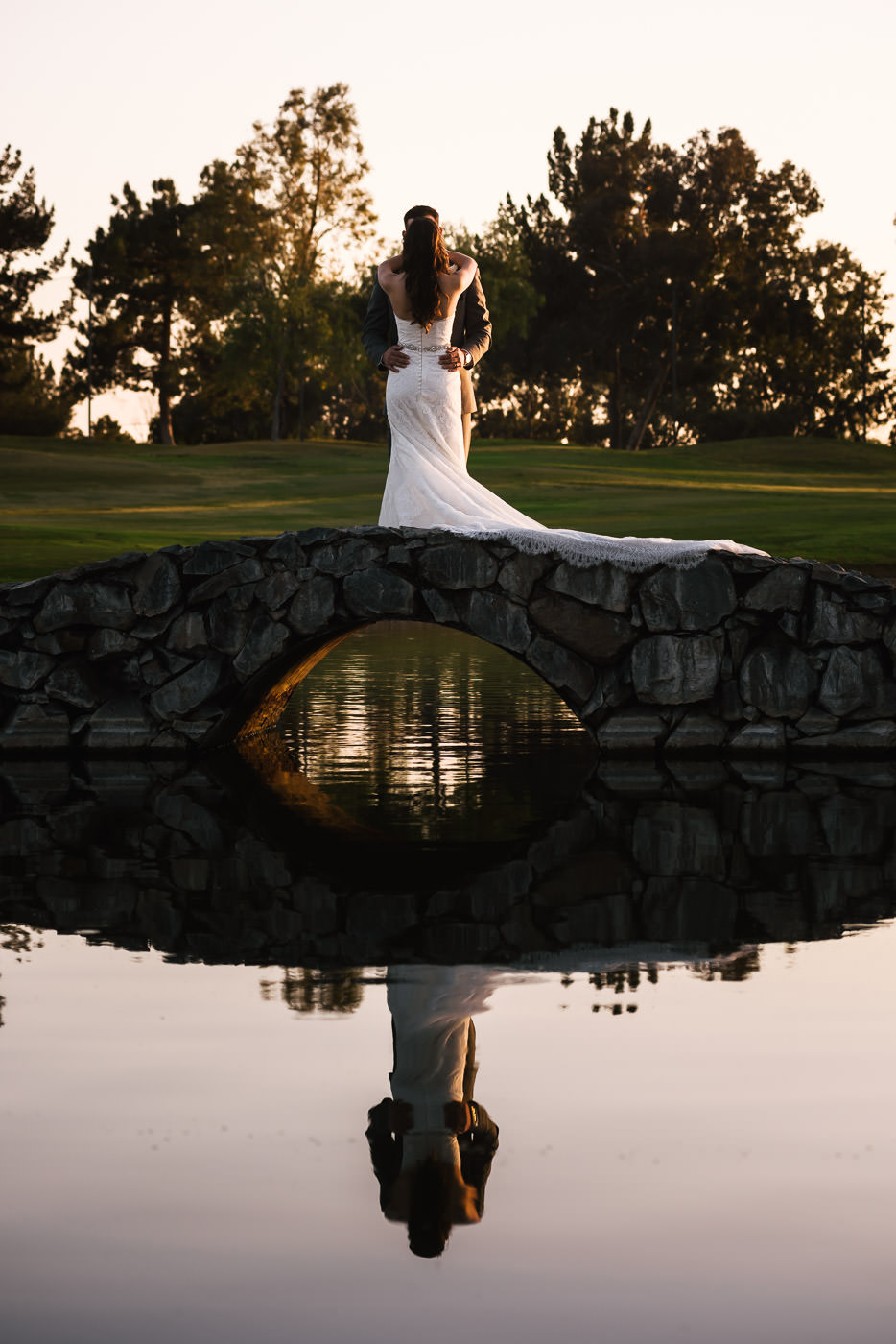 Romantic wedding photography on the stone bridge of the Alta Vista Country Club.