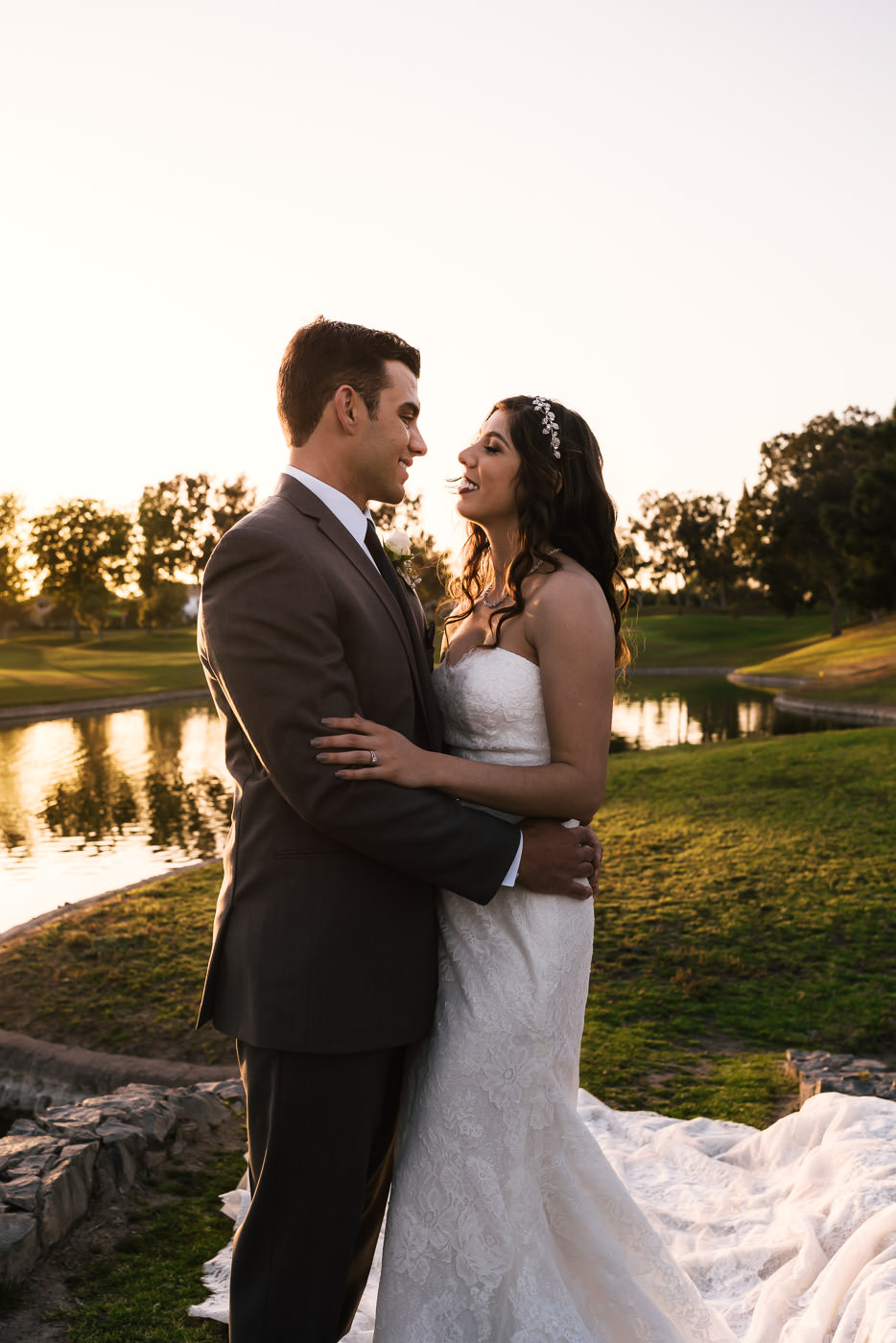 Beautiful couple gets close at sunset for a romantic photo session.