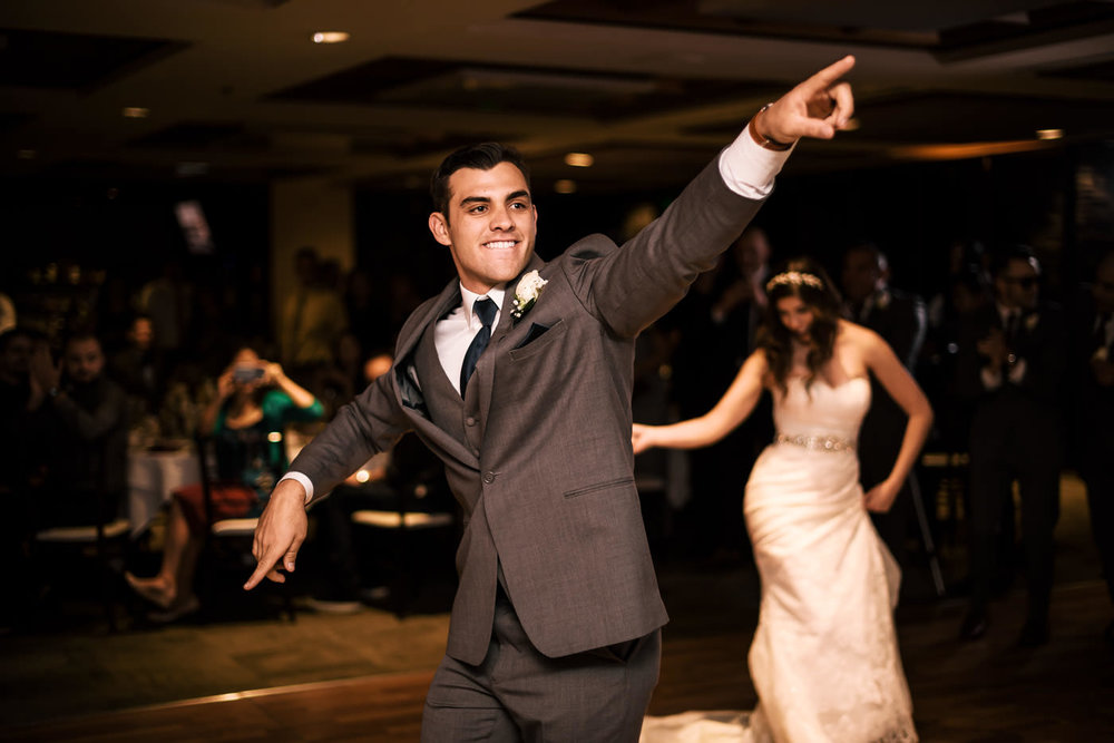 Newlyweds hit the dance floor at their reception for their first dance.