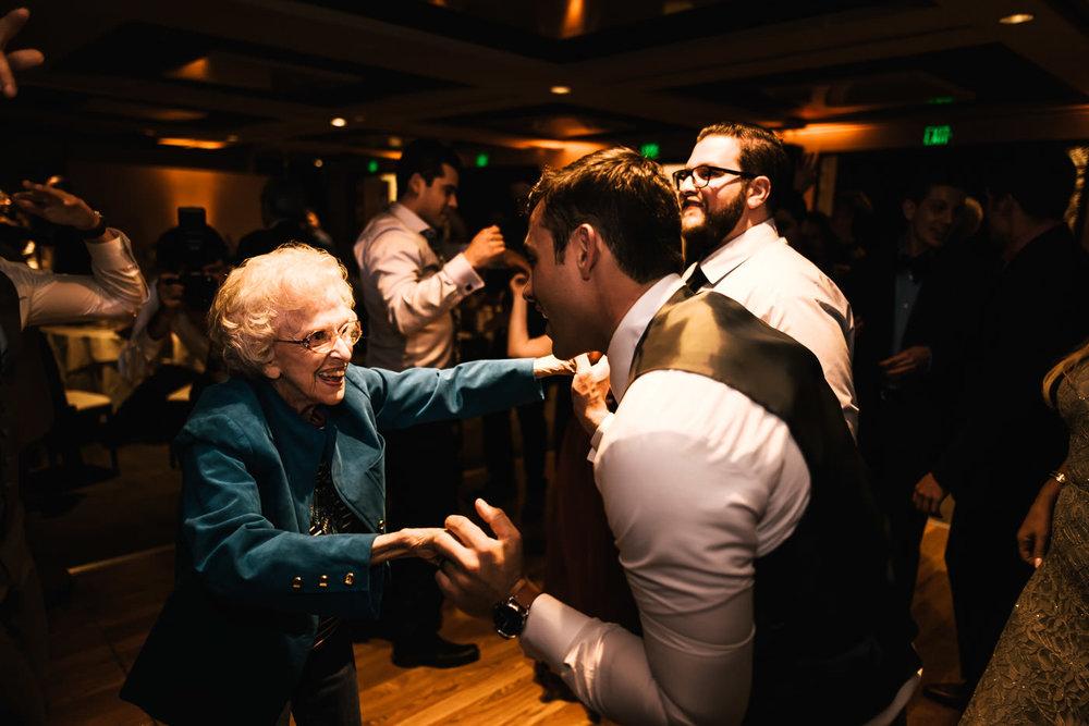 Groom tears up the dance floor with his grandma.