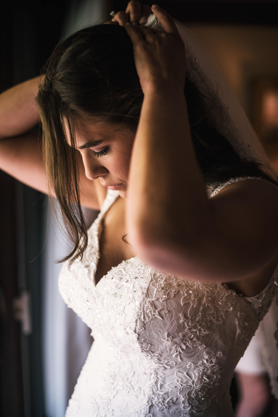 Bride fixes her wedding veil before heading of to the chapel.