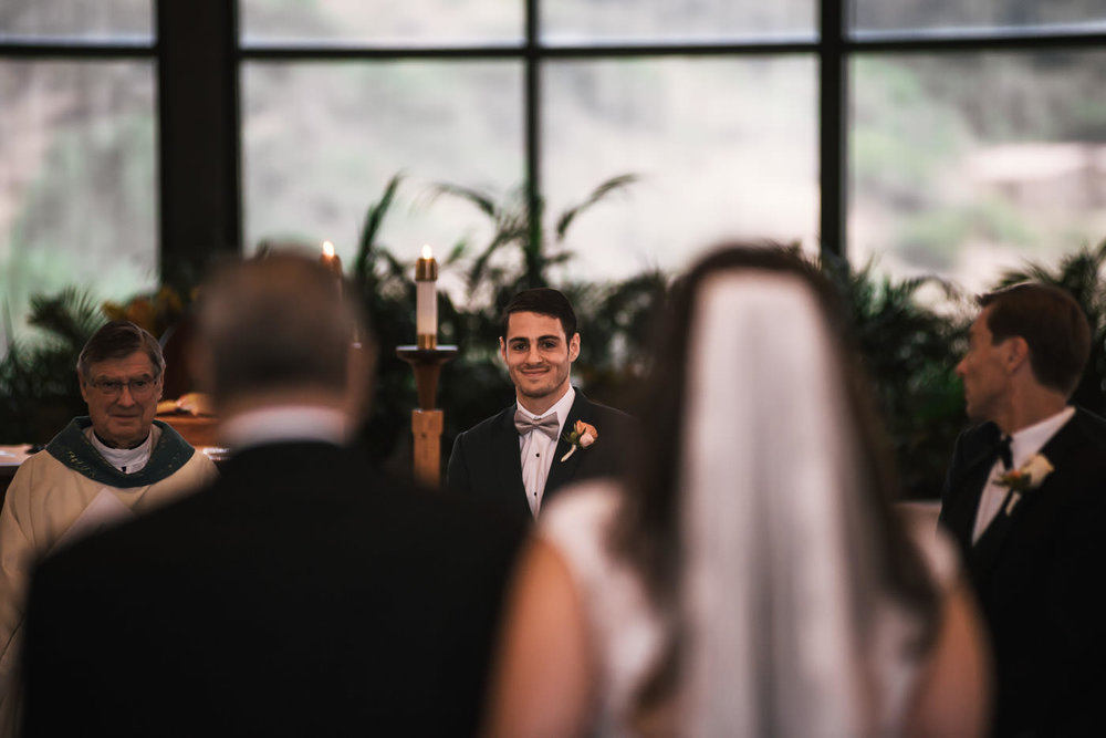 Groom is all smiles as he sees his wife to be for the first time on their wedding day.
