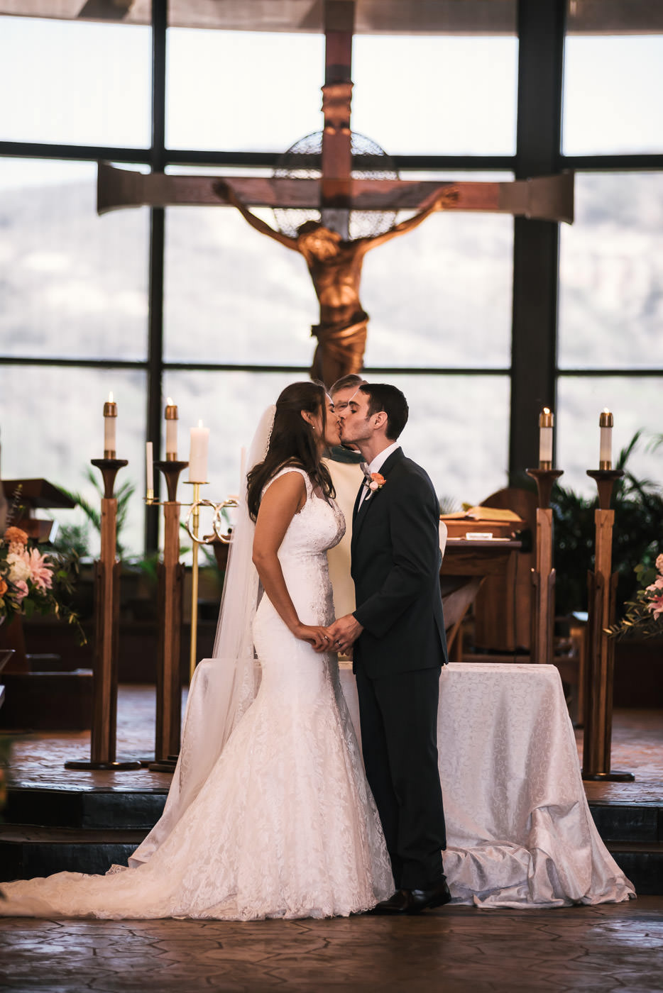 First kiss at this romantic wedding in St Therese Carmel Church.