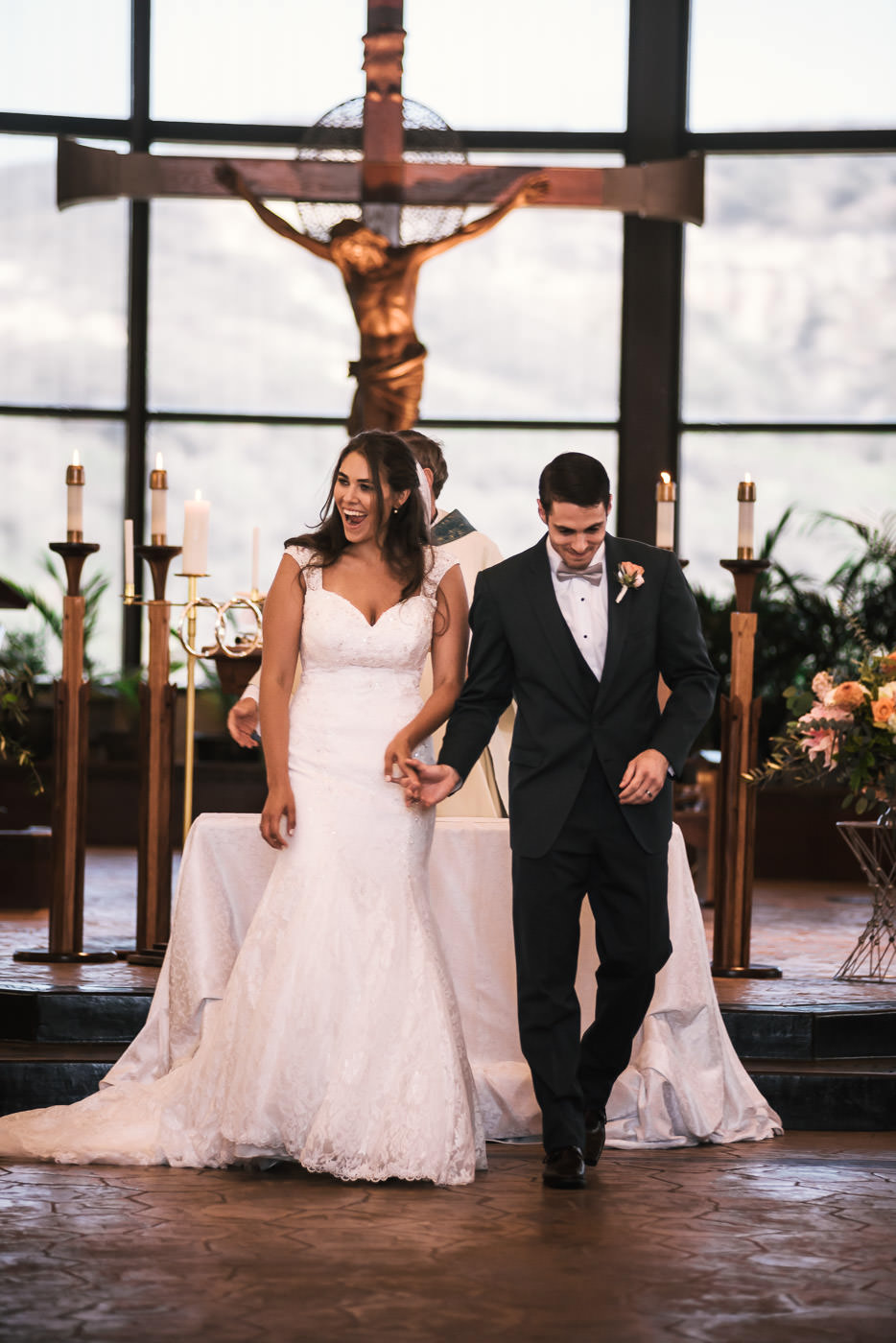 Newlyweds walk down the aisle for the time as husband and wife.