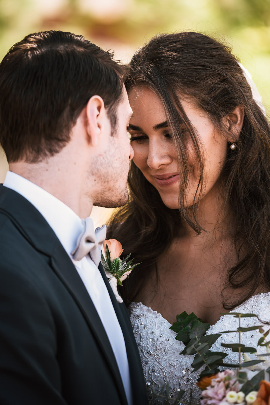 Couple gets close for an intimate photoshoot after their ceremony.